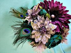 10 Peacock Feather Wedding Bouquets  www.dreamwedding.com/gallery/pretty-as-a-peacock-10-peacock-feather-wedding-bouquets