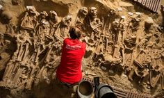 An archaeologists at works at the site of eight mass graves found under a store in Paris, Guardian 2 March 2015
