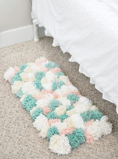 Learn how to create this amazing DIY Pom Pom Rug using Bucilla's new RyaTie™ Kits. This modern take on working with yarn is the perfect addition to any room