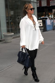 Over the weekend Beyonce Knowles was spotted out in Manhattan showing off her maternity style. She wore a loose-fitting white tunic, black pants, and a pair of Gianvito Rossi for Altuzarra patent leather goat- fur boots. What do you think about her look. See more pics below