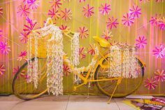 yellow bicycle , bicycle prop, white genda flower