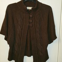 Sonoma cape-style cable knit sweater This is a cape-style sweater with cable knit detail.  It buttons at the top and then flows out.  The sleeves are loose and drapey.  Looks cute with an orange and brown skirt that I have listed for sale. Sonoma  Sweaters Shrugs & Ponchos