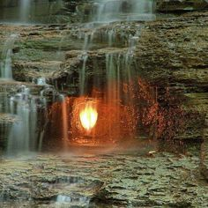 """This small waterfall located in the Shale Creek Preserve along a section of the Chestnut Ridge Park, near Buffalo New York has a rather interesting phenomena associated with it. The aptly named """"Eternal Flame Falls"""" sits on a pocket of natural methane gas, which seeps out through a fracture in the rocks behind the waterfall."""
