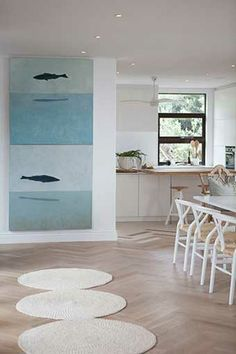 Michele Throssell Interiors > Beach house > Laid back, casual, comfortable textured interiors > Interior design > dining room > kitchen > wood herringbone floors > Kristen yang art