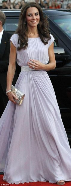 Kate Middleton walks the red carpet in LA today. White dress #katemiddleton, #royalcouple.