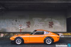 Datsun 280Z. My dad had one in this orange color when I was a kid.