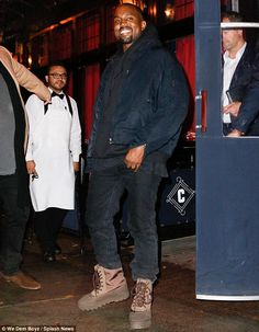 Happy chap: Kanye West enjoyed a celebratory dinner in New York City on Wednesday after winning Shoe Of The Year Award for his Yeezy Boosts