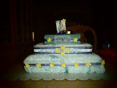 """I make diaper cakes for baby showers.. I thought up this cute idea for a bridal shower.Instead of purchasing a gift, I like to Purchase a towel set on the couple's registry- Bath towel, hand towel and wash cloth. I placed a 101 nights of great sex book wrapped in the bath towel, 5 love languages book wrapped in the hand towel and a GC to maybe fredricks or  Victoria's Secret. With a card that says """"Never let your love run dry!"""" :)"""