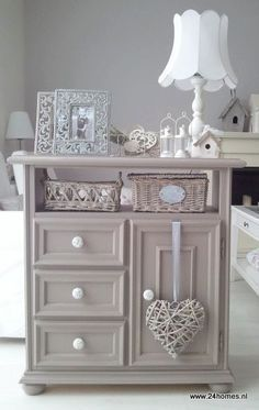take top drawer out and put bun feet on bottom of a plain chest and dress up with picture frames