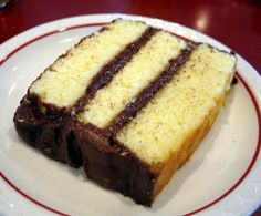 I don't think anything is more homey than a big fat piece of yellow cake slathered with chocolate frosting. This is the kind of cake your granny gave you, quite possibly set on a paper towel, and sent you out to the back porch so she could make a...
