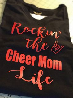 A personal favorite from my Etsy shop https://www.etsy.com/listing/533599915/rockin-the-cheer-mom-life-t-shirt