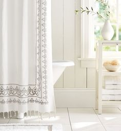 Bring bohemian to the bathroom with a tasseled shower curtain!