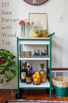 Diy gold ikea bar cart hack gold spray paint and a few for Panier de bar ikea bygel