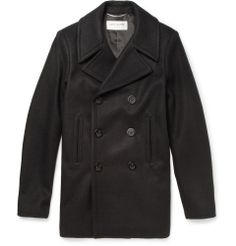 Saint Laurent - Wool Peacoat | Saint Laurent was one of the first labels to make peacoats cool in the 1960s, and its new designer Mr Hedi Slimane strips the iconic design back to basics with this wool version. By removing all detailing save a couple of pockets and anchor-engraved buttons, this jet-black piece focuses on the shape and fabric. Throw the collar up as you stalk city streets for razor-sharp style. Shown here with a Saint Laurent shirt, jeans and sneakers.