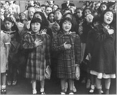 San Francisco, Calif., April 1942 - Children of the Weill public school, from the so-called international settlement, shown in a flag pledge ceremony. Some of them are evacuees of Japanese ancestry who will be housed in War relocation authority centers for the duration