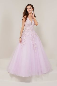 476e8b9e1e9 Style 16332 from Tiffany Designs is a sleeveless V neck prom gown with  metallic lace Appliques. French Novelty
