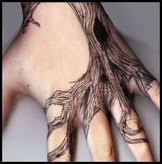tattoos that use the body to be more creative (like roots rapping around fingers) are just that much more cool!