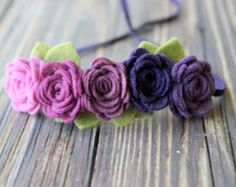 Like my facebook page for 10% off your next order! Just message me after you like my page and I will send you the coupon code. Help me get to 250 likes and I will do a giveaways!   Unique and beautiful felt flower garland headband This headband has 8 felt roses in pale peach and ivory accented with leaves and attached to an ivory skinny skinny elastic headband. Last photo shows the same headband in blush and cameo pink, also available in my shop  Want a different color scheme? I love custom…