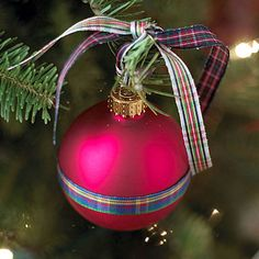 Pretty Plaid Ornament        Jazz up a glass ball ornament with plaid ribbon. Wrap a single length of ribbon around the ornament and secure with crafts glue. String two pieces through the ornament hanger and tie in a knot, leaving a loop to use for hanging. Use different patterns of plaid for a fun, casual look.