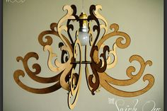 The Swirly One - Flatpack Wood Chandelier (small) by Godspeed Trading