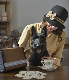 I don't know whether to file this under animals or clothing lol That is so a classier version of me with my dog :D