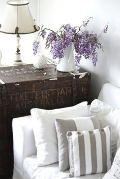 Wood Crate end table, Taupe and white pillows, Lilacs.