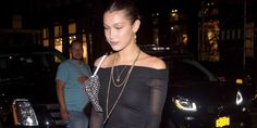 """Bella Hadid Falls in Boots That Literally Say """"For Walking"""""""
