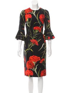 From the Fall 2015 Collection. Black, red and green Dolce & Gabbana midi dress with carnation print throughout, long bell sleeves and concealed zip closure at center back.