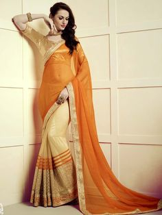 Innovative orange and golden color net and chiffon saree with kundan, zari work. Item Code: SNG17004 http://www.bharatplaza.com/new-arrivals/sarees.html