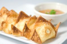 Crab Rangoon. Crabmeat and cream cheese stuffed in wontons, deep fried and served with a tangy sweet and sour sauce.