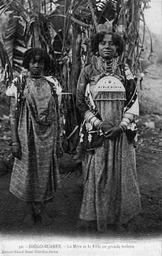 Africa   Mother and daughter dress up. Madagascar, Antsiranana province, Antsiranana (Diégo-Suarez)   Postcard image;Grand Bazar Charifou Jeewa. ca. 1905