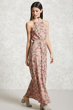 Style Deals - A woven maxi dress featuring an allover floral print, a high neckline, self-tie closure in the back with a keyhole cutout, and an elasticized waist.