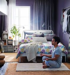Get Comfortable Room with Ikea Home Office Ideas: Good Looking Ikea Interior Design Ideas With Purple White Bedroom Scheme Also A Man Doing Yoga Activities On Grey Rug As Well As Brown Carpets And Double Sized Bed Along With Various Colors Of Pillows ~ wiligear.com Furniture Inspiration