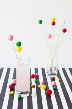 DIY Gumball Drink Stirrers - Use your (clean) awl to poke a hole through One Side of the Gumball. Pop it on a skewer. DONE!To add two gumballs to a skewer, poke a hole all the way through the gumball (it may be easiest to poke a hole on each side, meeting in the middle, for this), slide it on the skewer and then add another one on top. The only thing you need to remember is don't make the holes to large! The skewers should fit inside snugly. Make skewers different lengths.