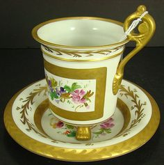 LARGE LIMOGES FLORAL CUP AND SAUCER