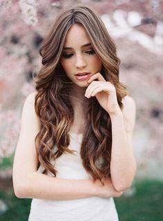 Wavy long hairstyle - perfect wedding hair! Image via Minnesota Wedding.