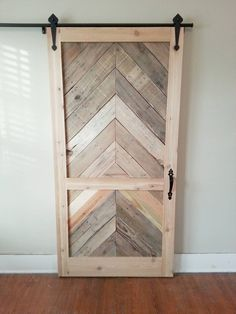 Using six pallets, plywood siding and pine boards, Everett Ballenger made a sliding door for his closet.
