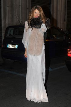 Take cues from ADR's mix of plush textures as she arrived at the Alberta Ferretti limited-edition event. This diaphanous floor-length Philosophy by Alberta Ferretti Spring '12 dress got an extra dose of loveliness thanks to two fur stoles.