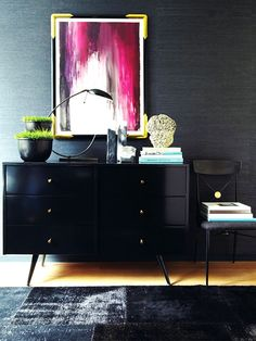 Simple bronze frame, pop of color against dark neutral walls. Heaven.