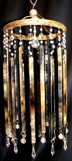 recycled chandelier gems and stained glass strips make a beautiful musical wind chime