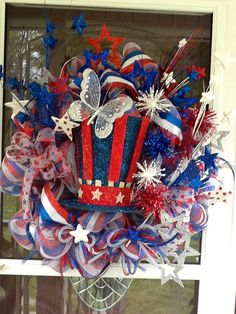 This Hat Lights up this wreath is loaded full of patriotic Stars ,Ribbons and everything 4th of July. This exact Wreath has sold , the hat will be