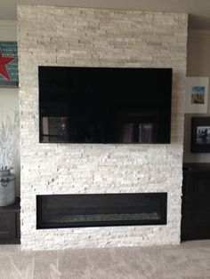 Concept for the living room fireplace. TV or art could hang above linear fireplace.