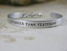 "Motivational Bracelet: A little motivation goes a long way and this handmade ""stronger than yesterday"" cuff bracelet ($23) is sure to get your fitness fanatic friend's fire going. Made of aluminum, with a tiny dumbbell charm, she's sure to appreciate looking down and getting the push she needs on those days she'd rather just chill on the couch."