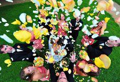 bridal party tossing flower petals