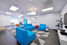 FLOR / Made You Look in multiple colors / Contingent/Wodify by Tao Design / Cherry Hill, NJ / The pops of color in the furniture add to the modern feel of Wodify's office space.