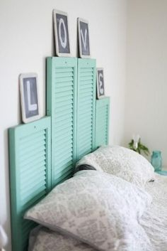 Paint some vintage shutters and arrange them on the wall behind your bed for an easy, cute headboard.