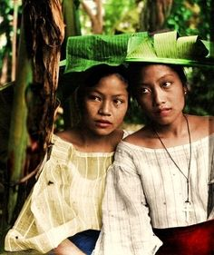 c. 1900's: This is a photo of Filipino women in the early 1900s. It was originally black and white, but i had it colorized.
