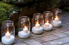 Holiday Candles A winter wonderland doesn't have to call for a lavish display. Create a snowy look by filling mason jars with Epsom salt and adding votive candles. Use battery operated candles instead. Outdoor Christmas, Simple Christmas, Winter Christmas, Christmas Holidays, Christmas Crafts, Xmas, Homemade Christmas, Christmas Candles, Christmas Wedding