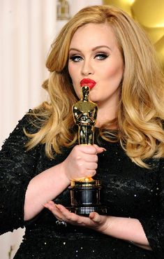 85th Annual Academy Awards - Press Room-Adele lays a kiss on her Oscar of Best Original Song
