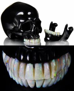 Black Obsidian skull. The skull is 5.3 inches long from front to back, it has a moveable jaw, and all the teeth are made of Australia opal. Via here